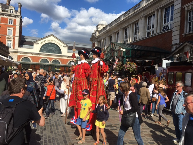 Festive costumes and street performers add life to Covent Garden