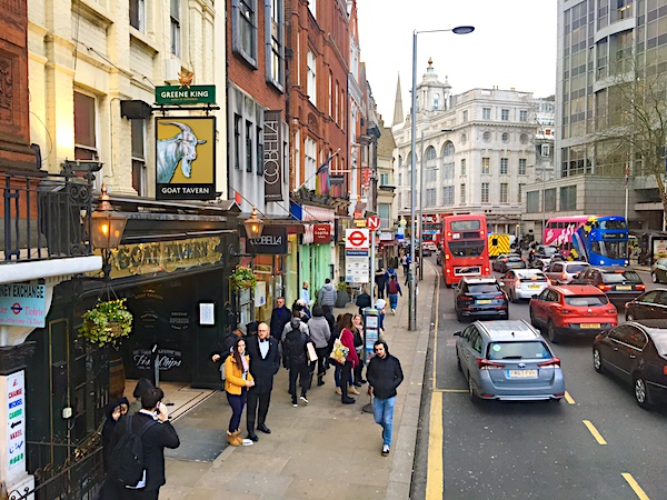 High Street Kensington bustles with people, pubs & plummy shops